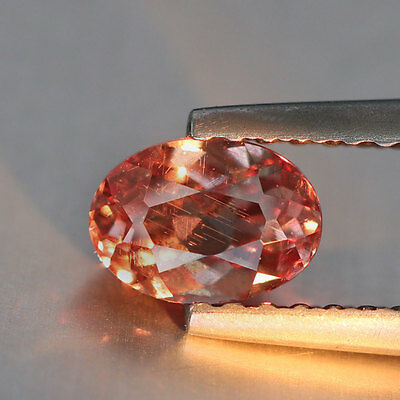 0.71 carat {Pink To Red} {Oval Cut} {Tanzania} {Malaya Garnet} PQ280