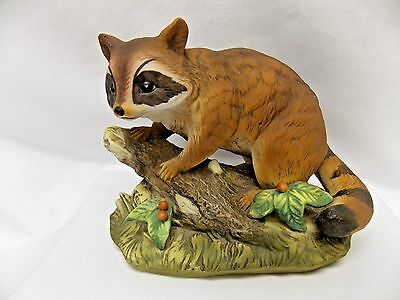 Raccoon on Log w/leaves Porcelain Figurine 6 1/2x5 Inch Made by Homco in Mexico.