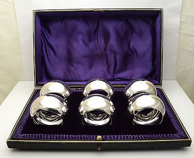 SIX ANTIQUE CASED SILVER NAPKIN RINGS ENGRAVED 1 -  6 HM SHEFFIELD 1911 169g