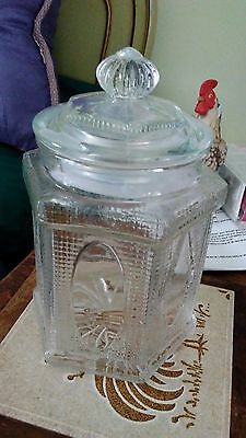 clear glass, vintage apathorary ,jar with lid, lacy upraised motif