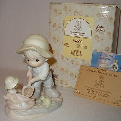 Precious Moments - Nothing Can Dampen The Spirit Of Caring Figurine - Mib