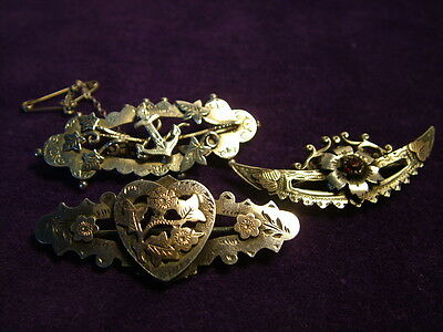 A good collection of antique solid silver Victorian sweetheart brooches