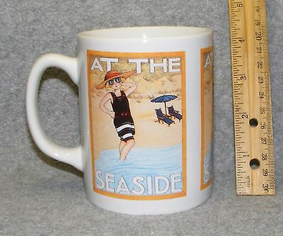 Mary Engelbreit ceramic coffee mug: At The Seaside girl on the beach; EUC