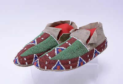 A pair of Fully Beaded Hide and Beaded Northern Plains Moccasins, late 19th cen