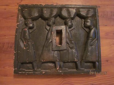Antique African ritual artifact, carved and blackened wood