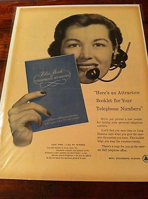 Vintage 1953 Bell Telephone System Operator Holding Blue Book Of Numbers ad