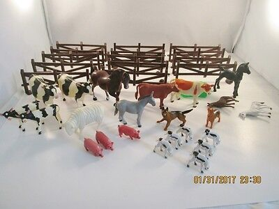 Assortment of Soft and Hard Plastic Animals and Fence