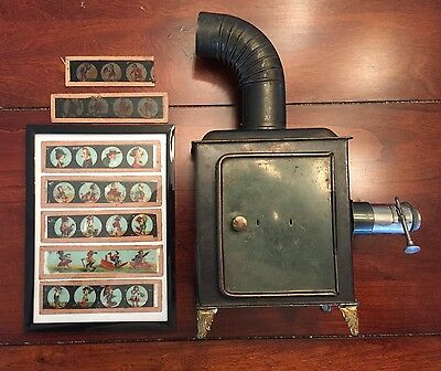 Antique Magic Lantern Projector with Seven Cartoon Glass Slides, Circa 1890's