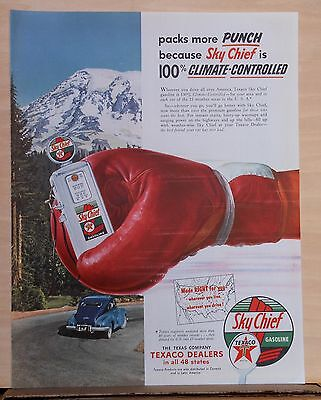1953 magazine ad for Texaco - Packs more punch, giant boxing glove holds pump