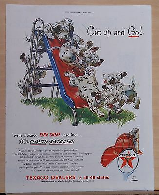 1954 magazine ad for Texaco - Dalmatian puppies play on slide, Get up and Go