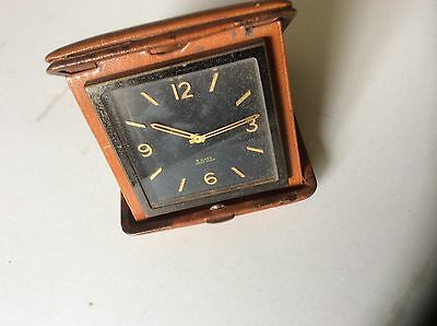 Vintage 8 Day Travel Clock black Dial  & Gold Color  numbers in Leather Case.