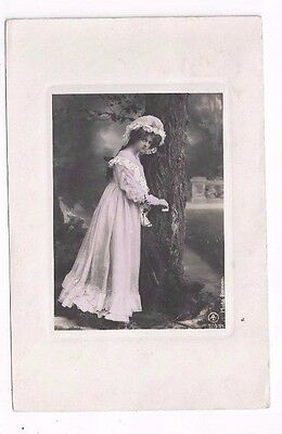 antique pretty lady photo post card beautiful young lady in pink stands by tree