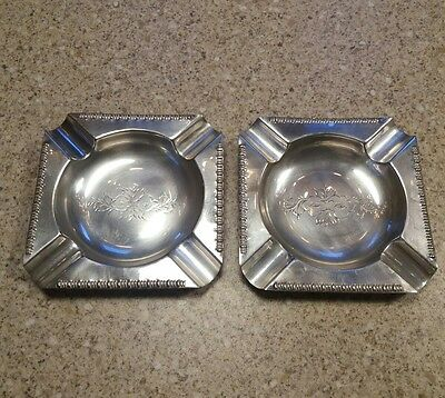 Vintage pair of silver plated ashtrays.