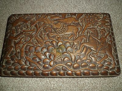 Antique wooden box with hand carved detail