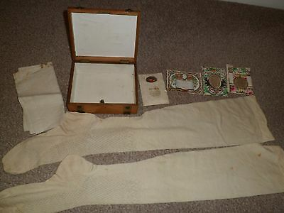 Vintage wooden box with contents