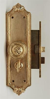 Gilded Doorknob Set with Emblematic Detail