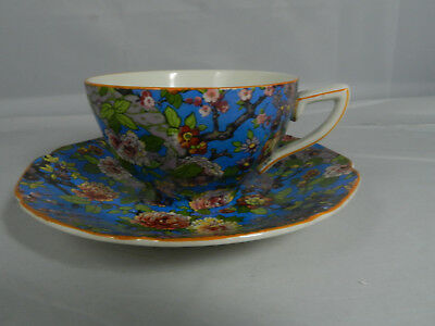 CROWN DUCAL Blue Chintz  Cup & Saucer Orange ? Ochre Rim