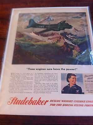 Vintage 1944 Studebaker B-17 Flying Over Snow Capped Mountains WW II Print ad