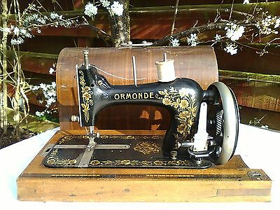 Beautiful Antique Ormonde hand turn sewing machine + case. Will ship worldwide.