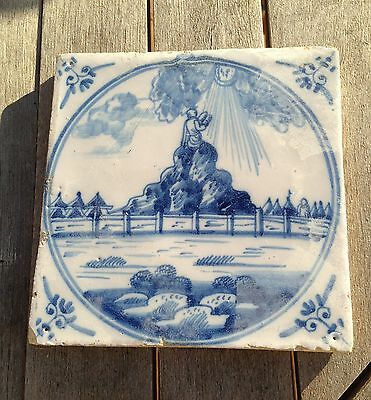 old blue and white tile showing moses with the commandments ?