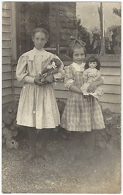 1910 REAL PHOTO Two Beautiful Girls with Toy Bear and Doll - Vintage Postcard