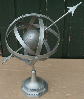 Unusual But Decorative Looking Metal Globe Thing With Arrow Throw It