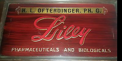 Antique Vintage H.L. Ofterdinger LILLY Pharmacy Advertising reverse painted Sign