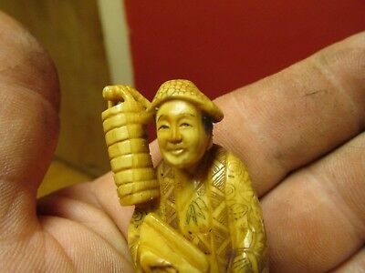 Japanese Carved Horn BONE  Netsuke Figure of man with bucket very nicely carved