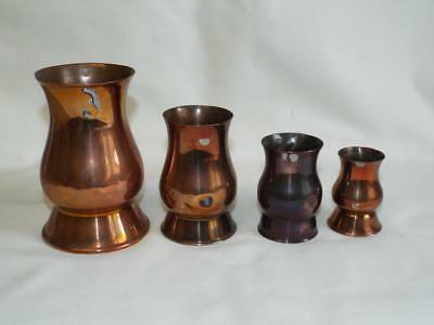 Four antique graduated copper gill measures.