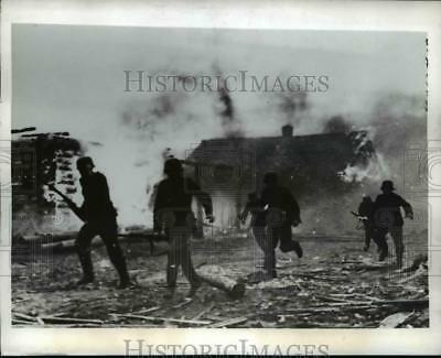 1941 Press Photo German Soldiers Storm a Soviet Village That Burns Furiously