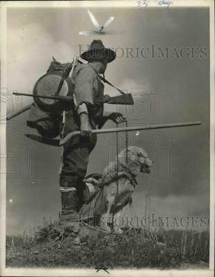 1936 Press Photo Klondiker with Pack Dog Hopes for Gold in Yukon Hills