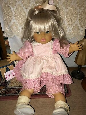 Age unknown Eegee Baby doll with platinum blonde hair in pink gingham dress