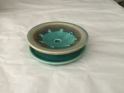 Turquoise pottery flower frog with attached underplate