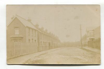 Unidentified British street scene, houses - early real photo postcard