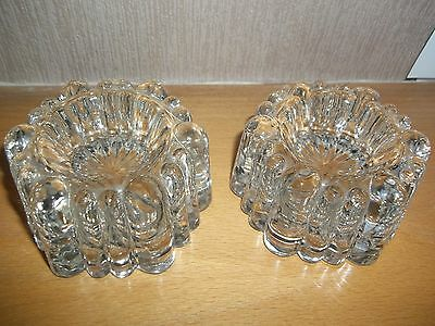 solid glass candle holders