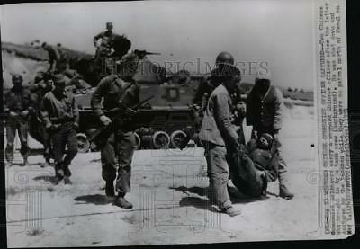1951 Wire Photo Two Chinese communist prisoners, carry wounded Chinese officer.