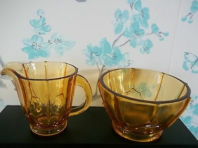amber glass milk and sugar bowl