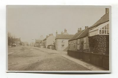 Unidentified British street scene, houses - old real photo postcard