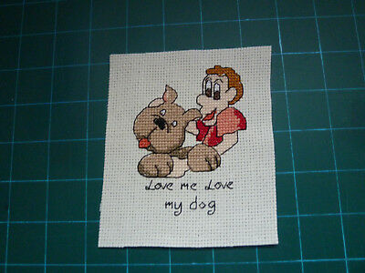 completed cross stitch.topper...