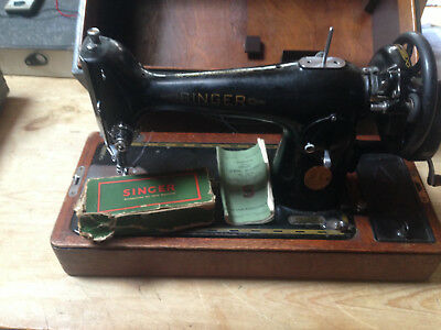 Vintage Singer sewing machine 201k with case and instruction book.