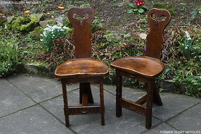 A Pair Of Rupert Nigel Griffiths Monastic Carved Oak Cottage Hall Chairs Stools