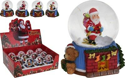 Christmas Snow Globe Christmas Snowglobe on Fire Place with Stockings Santa