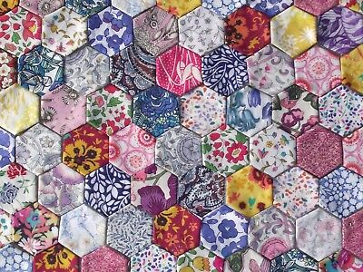 100 x small  patchwork hexagons Liberty Lawn, tacked to paper template set C
