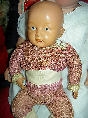 Adorable, antique German, jointed celluloid bent-limb baby doll, fine quality