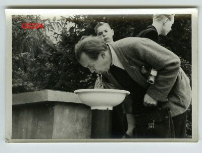 1960s VINTAGE PHOTO SNAPSHOT MAN DRINKING FROM FOUNTAIN