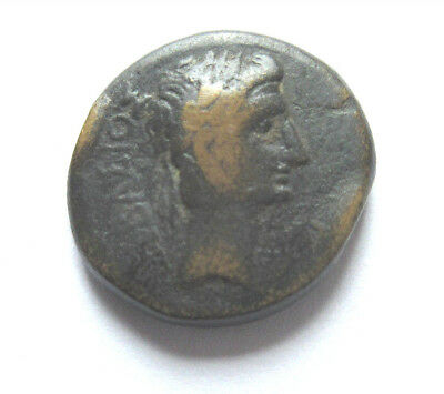 Ae-19 of Augustus from Laodiceia in Phrygia     Rv. Zeus standing left