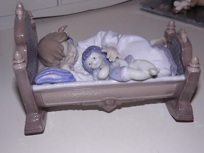 LLADRO Figurine Girl in cradle holding a doll. 5717