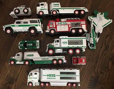 Large Lot of 11 Hess Fire Trucks Toy Trucks Helicopter Race Car