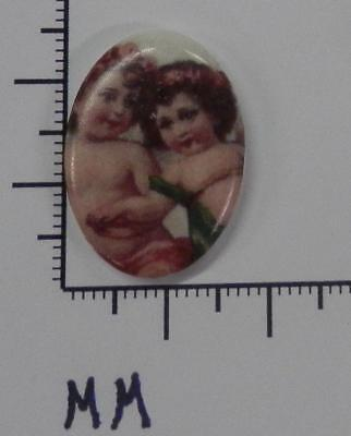 70700            Porcelain -  Two Cupids On  Oval   25x18 mm - by dz SALE