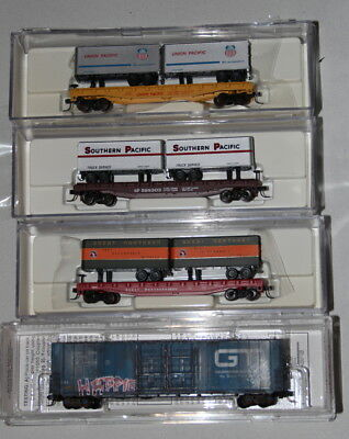 3 Atlas flats with semis and 1 Micro trains box cvar